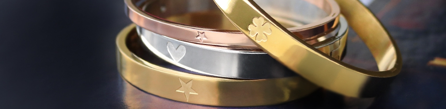 Stainless steel bangles with cute designs, unique make-up bags and festive earrings!