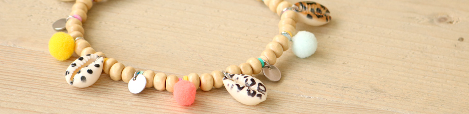 New! Cowrie shells with print and coloured pompom charms